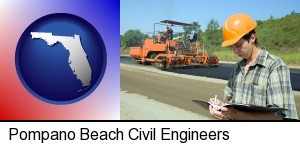 a civil engineer inspecting a road building project in Pompano Beach, FL