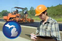 michigan map icon and a civil engineer inspecting a road building project
