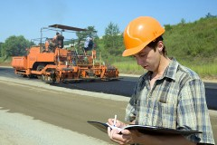 civil engineer inspecting a road building project