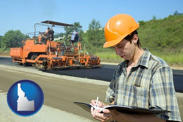 a civil engineer inspecting a road building project - with Idaho icon