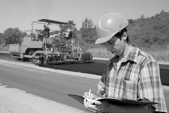 a civil engineer inspecting a road building project